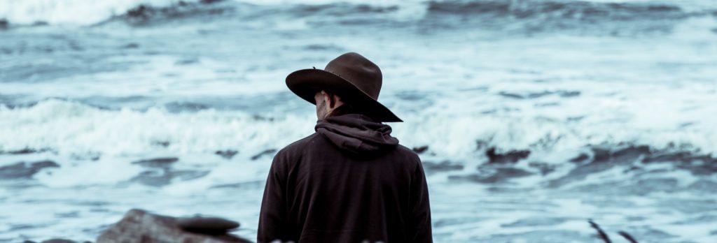 western cowboy looking at ocean